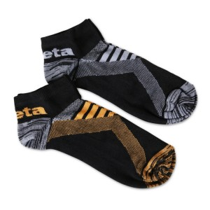 Two pairs of sneaker socks with breathable texture inserts One pair in black/orange colour and one pair in black/grey colour